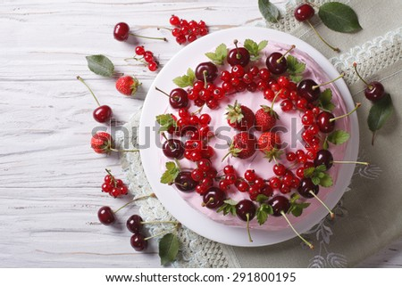 cake decorated fresh berries on the table close-up. horizontal view from above