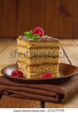 Cake decorated with raspberries and mint. (honey cake)