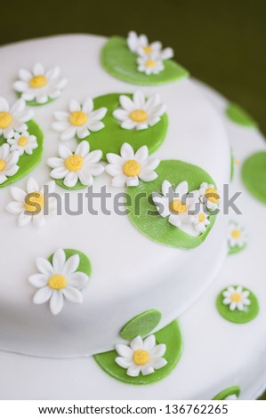 Cake decoration with flowers closeup - stock photo