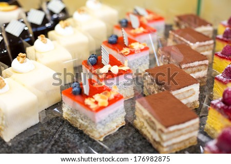 Cake displayed in shop window of confectionery or cafe - stock photo