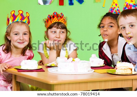 Cake eating contest at birthday party - stock photo