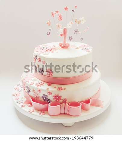 Cake for first birthday. Decorated, with number one on top and stars around it made of sugar.  - stock photo