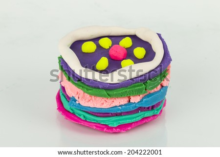 Cake from children bright plasticine - Stock Image macro. - stock photo