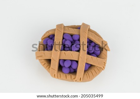 Cake from children bright plasticine - Stock Image macro. - stock photo