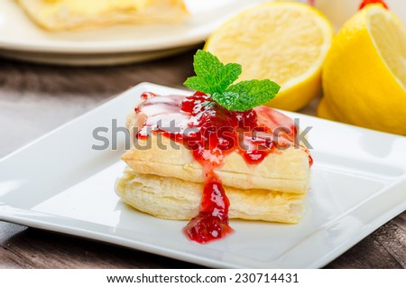 Cake from flaky pastry with jam and cranberries, all homemade. - stock photo