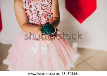 cake in children's hands - stock photo