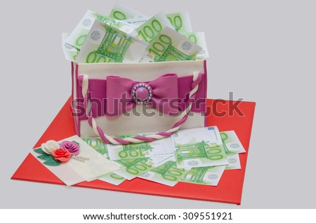 cake like woman bag with hundred euro money on gray - stock photo