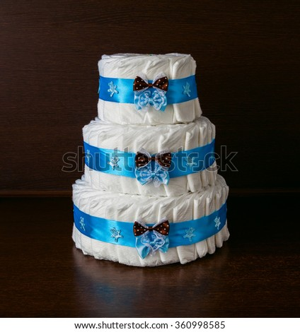 cake made from diapers with blue ribbon and bows - stock photo