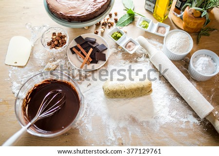 Cake making.Cookie dough..Preparations for making homemade chocolate.Mixed ingredients prepared for baking cake or bake.A whisk in a round bowl with liquid chocolate.Housewife making a chocolate cake - stock photo
