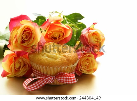 cake muffin with a bouquet of roses - sweet gift - stock photo