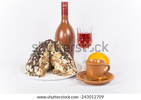 cake new year's eve with a Cup of coffee and a glass of liqueur - stock photo