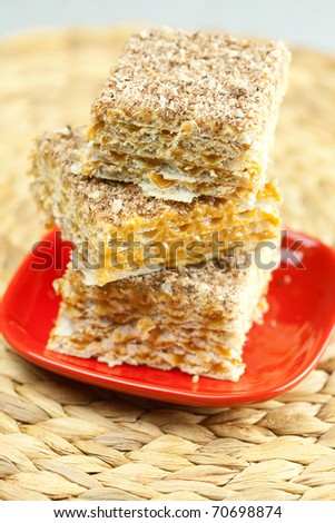 cake on a plate on a wicker mat
