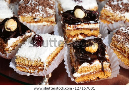Cake pieces on party table - stock photo