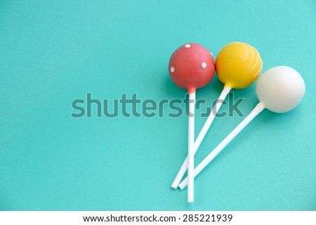 cake pops on blue background - stock photo