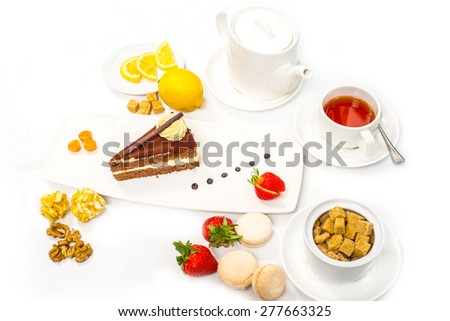 cake served with fresh fruits and tea - stock photo
