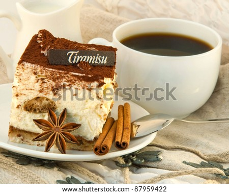 Cake tiramisu and a cup of hot coffee - stock photo