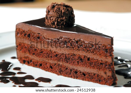 cake truffle with black chocolate sauce - stock photo