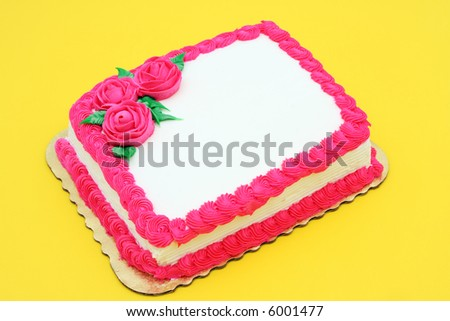 Cake, white and pink icing, yellow background - write your own message - stock photo