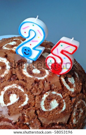 cake with a number twenty-five on top.Birthday, anniversary, etc.(vertical)