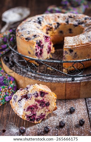 cake with black currants on a dark wooden background - stock photo