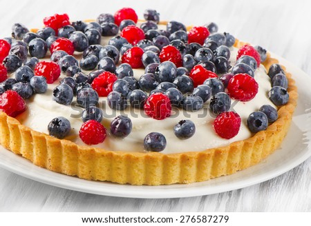 Cake with  blueberries on a white plate. Selective focus - stock photo