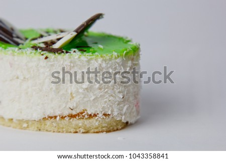 cake with chocolate and coconut chips. cake with green jelly. sweetness on a white background