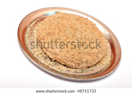 cake with chocolate and coconut crumbs isolated on white