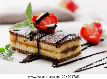 Cake with chocolate and strawberries. Selective focus - stock photo