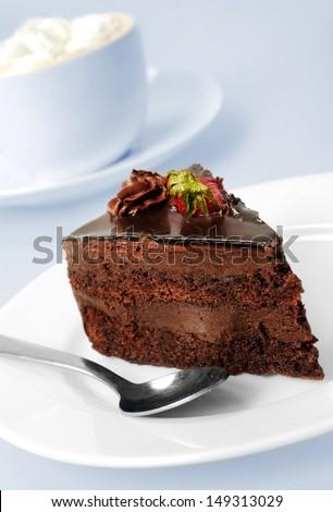 Cake with chocolate on grey background  - stock photo