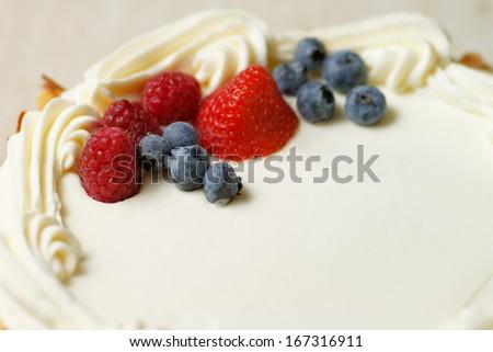 Cake with cream and berries - stock photo