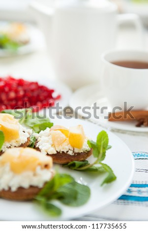 Cake with cream cheese and pear - Breakfast tea, close up - stock photo