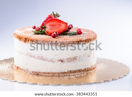 Cake with Cream, decorated with strawberries on a light background - stock photo