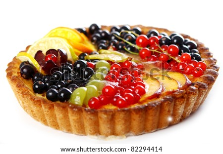 Cake with currant berries and citrus fruits isolated on white background - stock photo