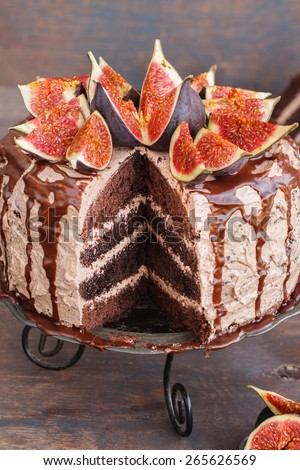 Cake with figs and chocolate glaze.selective focus - stock photo