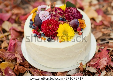 cake with flowers and fruits - stock photo