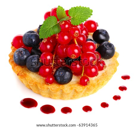 Cake with fresh berries and sauce on white isolated background - stock photo