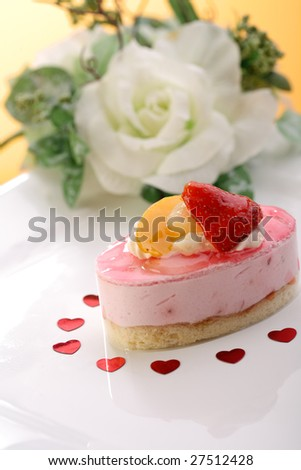 Cake with fresh fruits and flower - stock photo