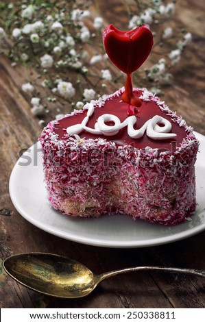 cake with fruit filling in the shape of heart with the inscription love