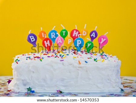 Cake with happy birthday balloon shaped candles - stock photo