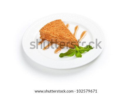 cake with honey and mint leaf on a plate with white background - stock photo