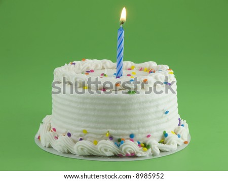 Cake with lit candle - stock photo