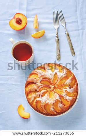 cake with peaches on a blue background. toning. selective focus on the middle of the pie - stock photo