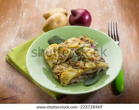 cake with potatoes and onions - stock photo