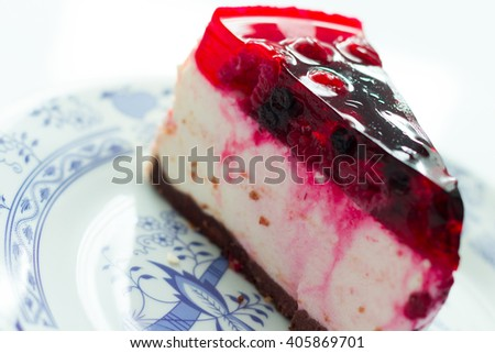 Cake with raspberries, white plate on an white background, top view - stock photo