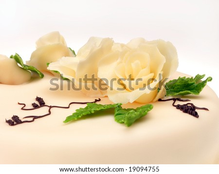 Cake with real looking roses. Closeup view. - stock photo