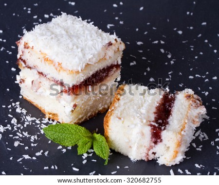 Cake with sprinkles of coconut and mint leaves