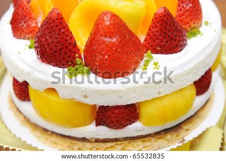 Cake with strawberry and mango - stock photo