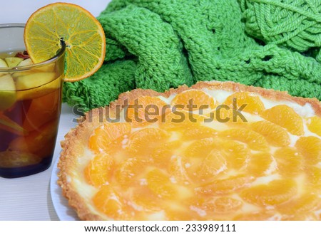 Cake with tangerines and mulled wine with tangerines and apples - stock photo