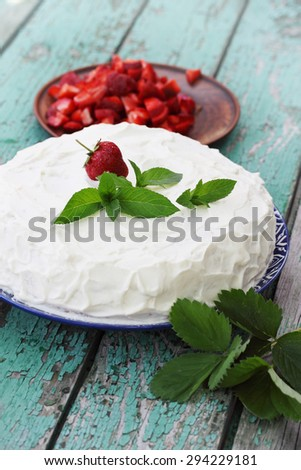 cake with whipped cream, strawberries and mint - stock photo