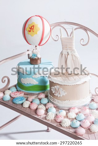 cakes for baptism and other candies i a vintage chair - stock photo